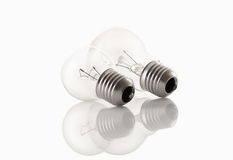 Two light bulbs  on white with reflects Stock Image