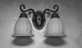 Two light fixture. On wall sconce Stock Photography