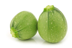 Two light green round zucchinis Royalty Free Stock Photo