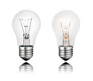 Two Lightbulbs On and Off with Reflection Isolated Royalty Free Stock Photography