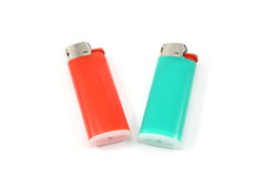 Two Lighters. Two colorful lighters on a white background Royalty Free Stock Image