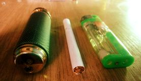 Two lighters one cigarette Royalty Free Stock Photos