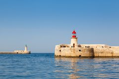 Two lighthouse in Grand Harbour. (Valletta, Malta Stock Images