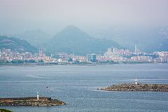 Two lighthouses in Black Sea in city Giresun, Turkey. With mountain panorama stock images