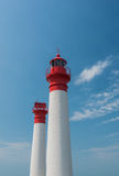 Two lighthouses  on a blue sky Royalty Free Stock Photo
