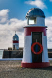 Two lighthouses at Castletown in the Isle of Man. Lighthouses on the inner and outer harbor at Castletown in the Isle of Man royalty free stock photo