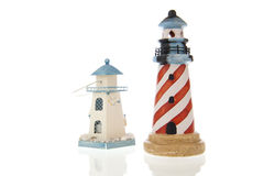 Two lighthouses in closeup and isolated in white Stock Photos