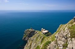 Two lighthouses on high, precipitous rocks. Stock Photography