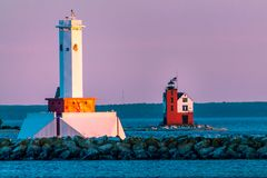 Two lighthouses during a pink sunset on Mackinac Island Michigan. During the summer royalty free stock images