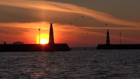 Two lighthouses in  port during sunrise. Two lighthouses in the port during sunrise stock video footage