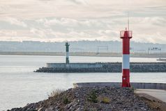Two lighthouses. At exit from Neva Bay against background of St. Petersburg dam. Kronstadt, Russia stock photos
