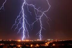 Two lightnings in the night sky. Lightning, lightnings, sky, city, night, flash, blow, earth, two, factory, Mariupol, danger, charge, dangerous, electric Stock Photos