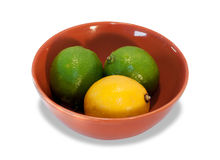 Two lime and lemon in brown bowl Stock Photo
