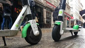 Two Lime-S Electric Rental Scooter In Lyon France. Lyon, France - January 4, 2019: Two Lime-S Electric Rental Scooter Parked In The Rue Merciere Street In Lyon stock footage