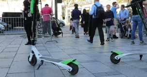 Two Lime-S Electric Rental Scooter In Paris. Paris, France - October 16, 2018: Two Lime-S Electric Rental Scooter On The Champs Elysees In Paris, France, Europe stock video footage