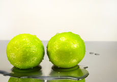 Two lime in water drops Stock Photography