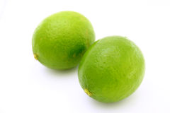 Two limes. On a white background Royalty Free Stock Photos