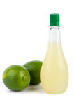 Two limes and bottle of juice Royalty Free Stock Photos
