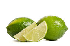 Two limes with slices of  juicy lime Royalty Free Stock Images