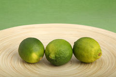 Two limes on a wooden cutting board Royalty Free Stock Image