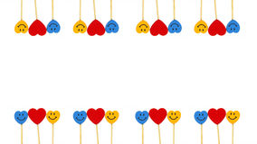 Two line hearts between two smile faces in white background. Two line hearts between blue and yellow colored smile faces in white background Stock Image