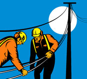 Two linemen at work Royalty Free Stock Photos