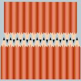 Two lines of crayons set in orange cover on lue background stock illustration