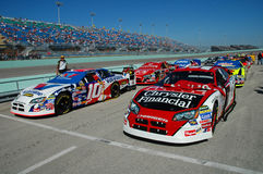 Two lines of NASCAR cars on pitt lane Stock Photos