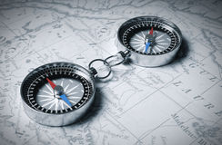 Two Linked Compass On The Map Royalty Free Stock Photo