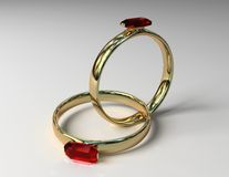 Two linked gold rings Royalty Free Stock Image
