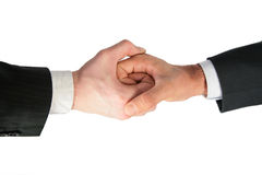 Two linked hands. On white stock image