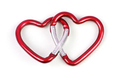 Two linked heart shaped carabiner. Red color stock photo