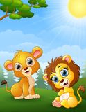 Two lion cub cartoon in the jungle stock illustration