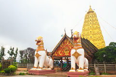 Two lion guard statues in Thai temple Stock Images