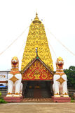Two lion guard statues in Thai temple Royalty Free Stock Photo