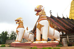 Two lion guard statues in Thai temple Stock Photography