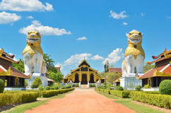 Two lions with ancient building at Surasri Camp Royalty Free Stock Images