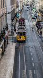 Two lisbon tram moving in rua de São Paulo lisbon, in a line and a normal day in lisbon stock photo
