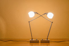 Two lit modern lamps Royalty Free Stock Photos