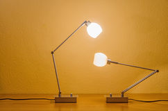 Two lit modern lamps Stock Image