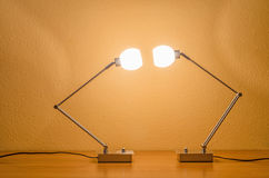 Two lit modern lamps Royalty Free Stock Images