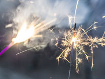 Two lit sparklers Royalty Free Stock Photography