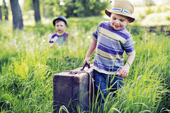 Two litle brothers starting the journey Royalty Free Stock Photography