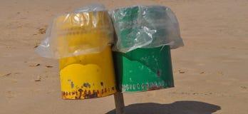 Two litter bins. Litter bin aka garbage or trash bin or waste bin on the beach royalty free stock images