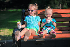 Two little adorable girls eating ice cream Stock Photos