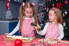 Two little adorable girls preparing gingerbread Royalty Free Stock Photography