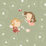 Two little angels with flowers Stock Image