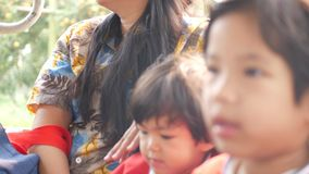 Two little Asian baby girls, sisters, enjoyed taking a truck together with their mother.  stock footage