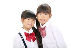Two little asian schoolgirls Stock Image