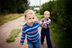 Two little baby boy walking Royalty Free Stock Photo